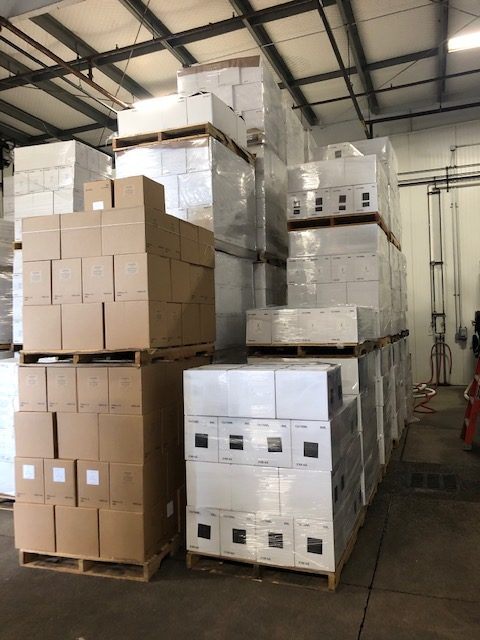 Palletized cases of labeled wine
